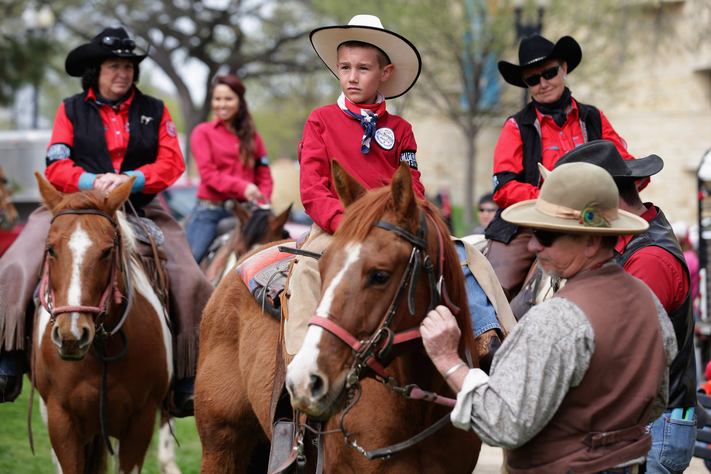". Members of the Cowboy and Indian Alliance, including Native Americans, farmers and ranchers from across the United States, prepare for a horseback ride as part of a demonstration against the proposed Keystone XL pipeline April 22, 2014 in Washington, DC. As part of its ""Reject and Protect\"" protest, the Cowboy and Indian Alliance is organizing a weeklong series of actions by farmers, ranchers and tribes to show their opposition to the pipeline.  (Photo by Chip Somodevilla/Getty Images)"