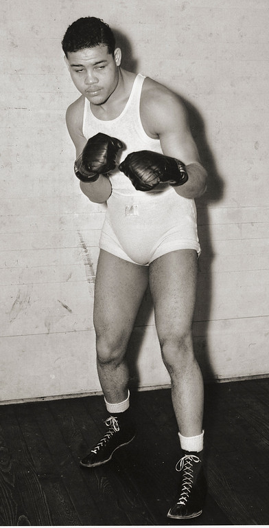 . Joseph Louis Barrow (May 13, 1914 � April 12, 1981), better known as Joe Louis, was an American professional boxer and the World Heavyweight Champion from 1937 to 1949. He is considered to be one of the greatest heavyweights of all time. He is widely regarded as the first African American to achieve the status of a nationwide hero within the United States. Joe Louis, nicknamed the Brown Bomber, is photographed in his boxing apparel on January 27, 1937 in Pompton Lakes, NJ. He was born in 1914 in Lafayette, AL., and died in 1981. (AP Photo)