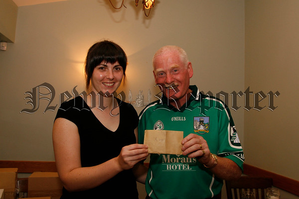 Rosie Markey on behalf of Rostrevor Golfing society presents a cheque to Harry Morgan for his daughter Ashling who is competing in the special olympics, 07W33N65