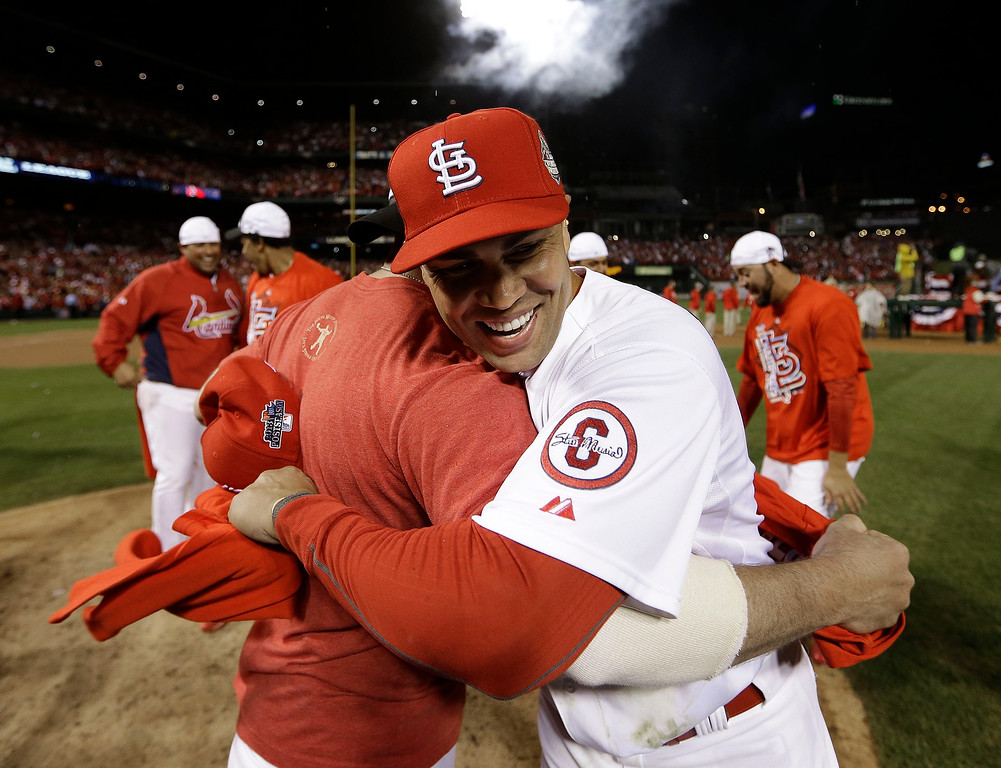 . St. Louis Cardinals\' Carlos Beltran hugs a teammate after Game 6 of the National League baseball championship series against the Los Angeles Dodgers, Friday, Oct. 18, 2013, in St. Louis. The Cardinals won 9-0 to win the series. (AP Photo/David J. Phillip)