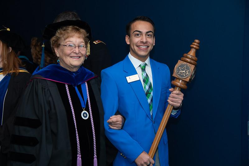 Dr. Elizabeth Sefcik, Professor of Nursing and 2019 regents professor award recipient, carries the ceremonial mace during opening ceremonies.A.M.