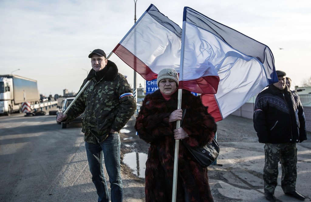. Pro-Russia supporters wave Crimean flags at Chongar checkpoint blocking the entrance to Crimea on March 10, 2014. Russia vowed on March 10 to unveil its own solution to the Ukrainian crisis that would run counter to US efforts and would appear to leave room for Crimea to switch over to Kremlin rule. The unexpected announcement came as Ukraine\'s new pro-European leaders raced to rally Western support in the face of the seizure by Kremlin-backed forces of the strategic Black Sea peninsula and plans to hold a Sunday referendum on switching Crimea\'s allegiance from Kiev to Moscow. ALISA BOROVIKOVA/AFP/Getty Images