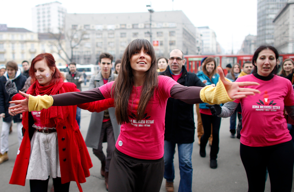 . People dance at a gathering of the \'One Billion Rising\' campaign in Belgrade February 14, 2013. \'One Billion Rising\' is a campaign to call for the end of violence against women, according to the organisers. REUTERS/Marko Djurica