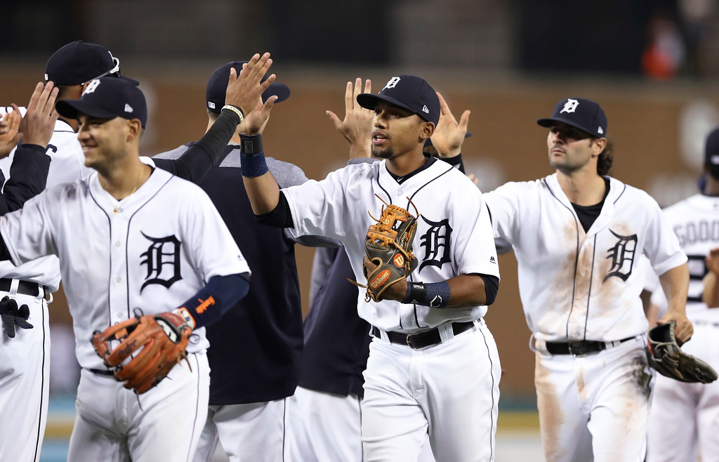 . Detroit Tigers shortstop Dixon Machado, center, and teammates celebrate after the Tigers defeated the Cleveland Indians 9-8 in a baseball game Tuesday, May 15, 2018, in Detroit. (AP Photo/Carlos Osorio)