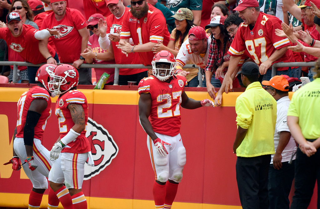 . Kansas City Chiefs running back Kareem Hunt (27) celebrates with fans his 53 yard touchdown, during the second half of an NFL football game against the Philadelphia Eagles in Kansas City, Mo., Sunday, Sept. 17, 2017. (AP Photo/Ed Zurga)