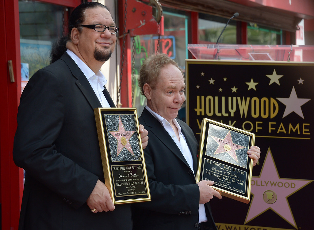 . American illusionists and entertainers Penn Jillette (L) and Teller are honored with a star on the Hollywood Walk of Fame on April 05, 2013 in Hollywood, California. AFP PHOTO/JOE KLAMAR        (Photo credit should read JOE KLAMAR/AFP/Getty Images)