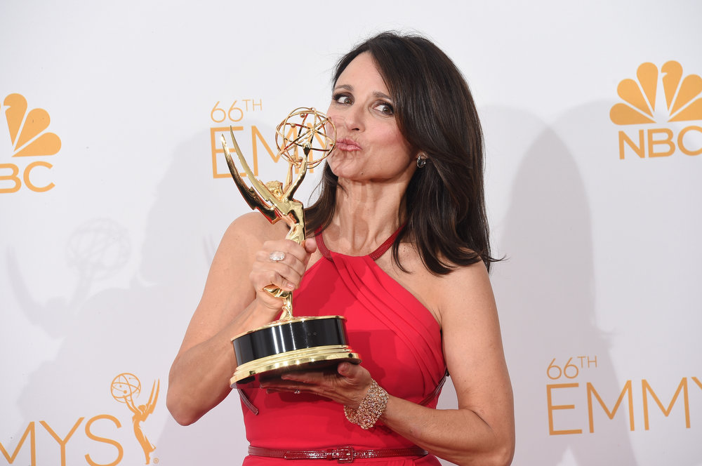 """. Actress Julia Louis-Dreyfus, winner of the Outstanding Lead Actress in a Comedy Series Award for Veep (Episode: \""""Crate\""""), poses in the press room during the 66th Annual Primetime Emmy Awards held at Nokia Theatre L.A. Live on August 25, 2014 in Los Angeles, California.  (Photo by Jason Merritt/Getty Images)"""