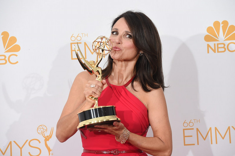 ". Actress Julia Louis-Dreyfus, winner of the Outstanding Lead Actress in a Comedy Series Award for Veep (Episode: ""Crate\""), poses in the press room during the 66th Annual Primetime Emmy Awards held at Nokia Theatre L.A. Live on August 25, 2014 in Los Angeles, California.  (Photo by Jason Merritt/Getty Images)"