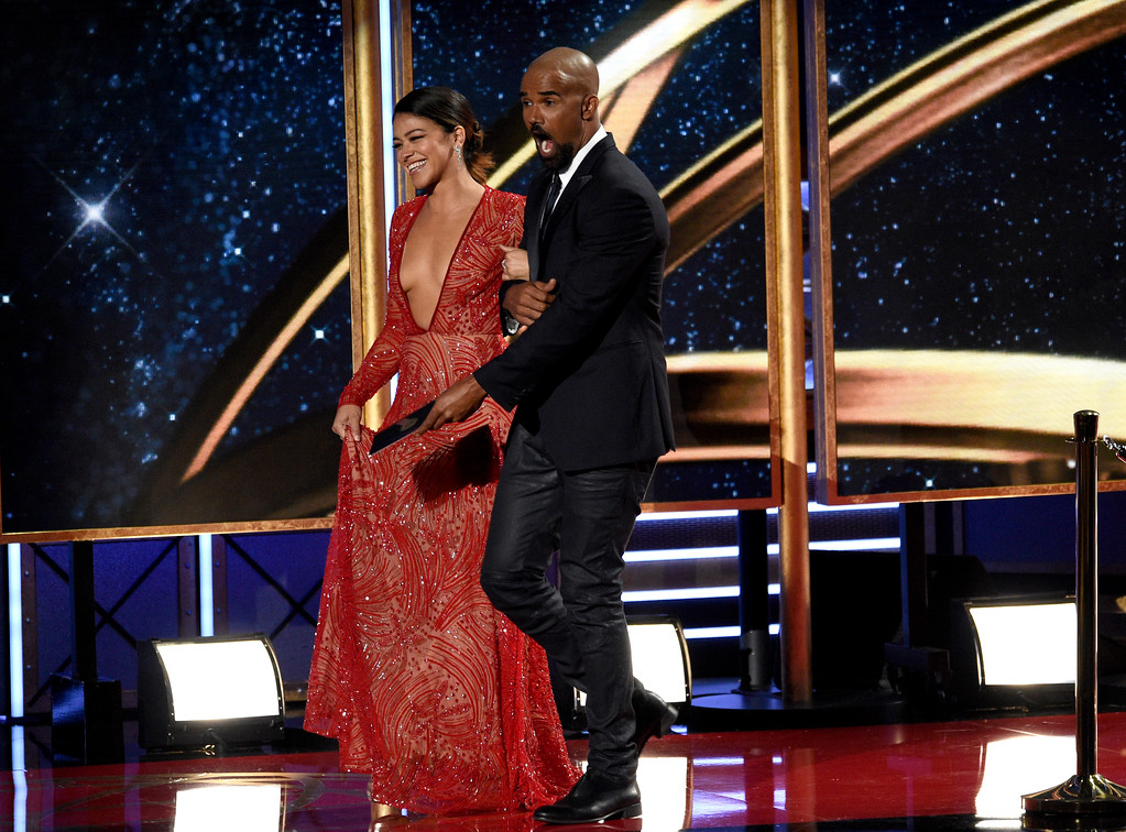 . Gina Rodriguez, left, and Shemar Moore present the award for outstanding supporting actress in a comedy series at the 69th Primetime Emmy Awards on Sunday, Sept. 17, 2017, at the Microsoft Theater in Los Angeles. (Photo by Chris Pizzello/Invision/AP)