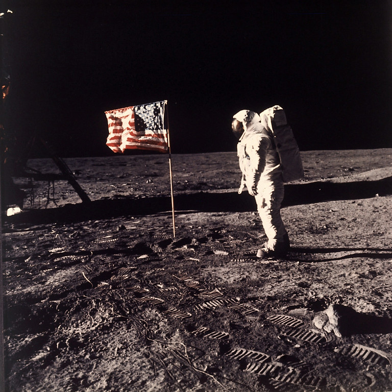 ". FILE - In this July 20, 1969 file photo provided by NASA shows astronaut Edwin E. ""Buzz\"" Aldrin Jr. posing for a photograph beside the U.S. flag deployed on the moon during the Apollo 11 mission.  Aldrin and fellow astronaut Neil Armstrong were the first men to walk on the lunar surface. The trio was launched to the moon by a Saturn V launch vehicle at 9:32 a.m. EDT, July 16, 1969. They departed the moon July 21, 1969. (AP Photo/NASA, Neil Armstrong, File)"