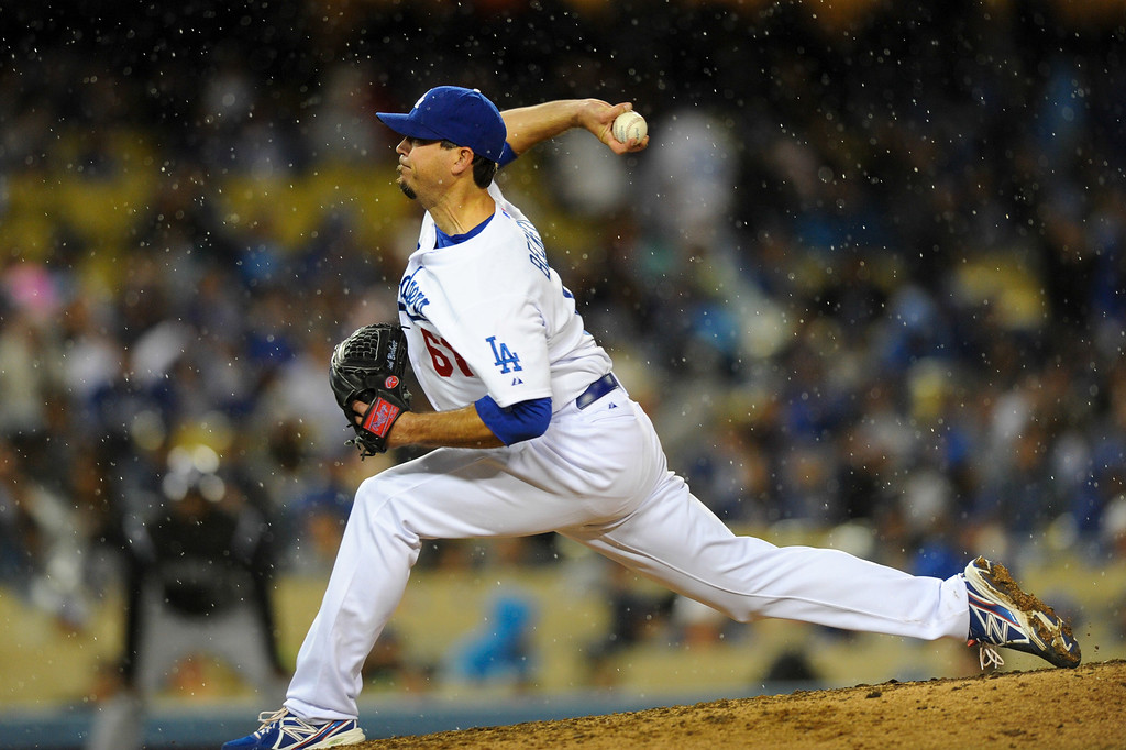 . The Dodgers\' Josh Beckett pitches in the rain against the Rockies, Friday, April 25, 2014, at Dodger Stadium. (Photo by Michael Owen Baker/L.A. Daily News)