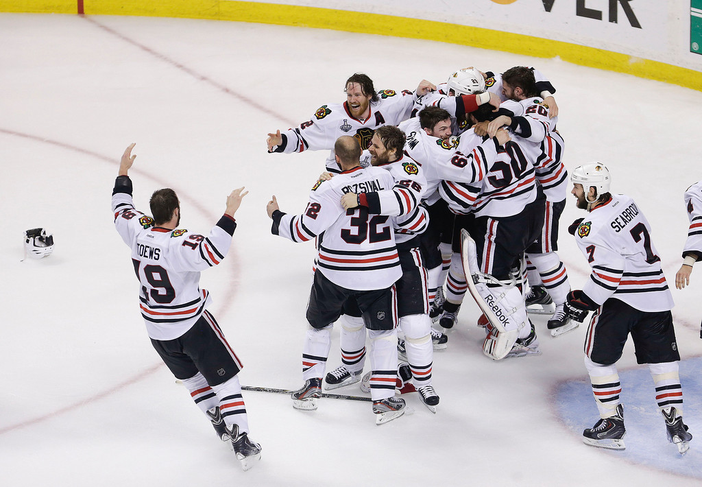 . The Chicago Blackhawks celebrate their 3-2 win over the Boston Bruins in Game 6 of the NHL hockey Stanley Cup Finals, Monday, June 24, 2013, in Boston. (AP Photo/Charles Krupa)