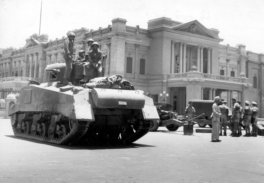 . During a coup d\'etat led by General Muhammed Naguib, Egyptian army tanks and field guns are drawn up in front of the royal  Abdin Palace, in Cairo, on July 26, 1952.  Appointed Premier Ali Maher Pasha issued an ultimatum to King Farouk I, forcing the Egyptian monarch to abdicate. (AP Photo)