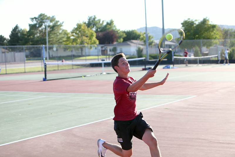 Scottsbluff's number three Owen Parra in a singles match with Alliance on Tuesday in Gering