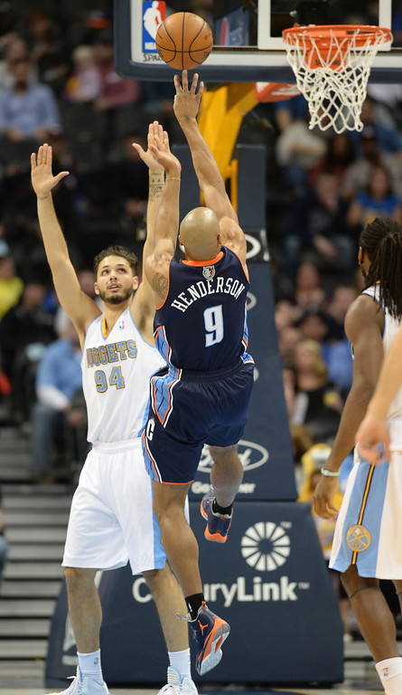 . Gerald Henderson of the the Charlotte Bobcats (9) makes the basket over Evan Fournier of the Denver Nuggets (94) in the second half. (Photo by Hyoung Chang/The Denver Post)