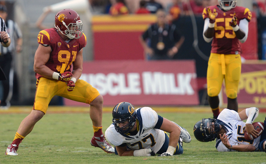 . USC\'s Morgan Breslin #91reacts after sacking CAL QB Zach Maynard #15 in the second half during their game at Los Angeles Memorial Coliseum September 22, 2012. USC beat CAL 27-9. (Hans Gutknecht/L.A. Daily News)