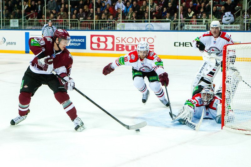 Miks Indrasis shoots to the goal of Donbass Donetsk during KHL regular championship game between Dinamo Riga and Donbass Donetsk in Arena Riga