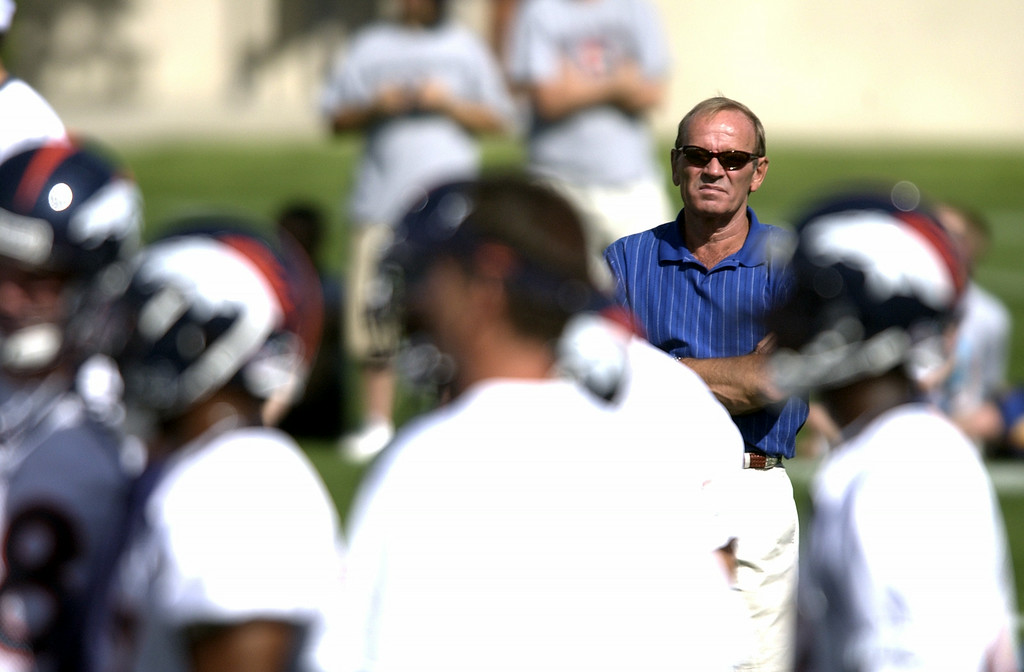 . Denver Broncos Owner Pat Bowlen watches the afternoon practice at Dove Valley in 2003.    (DENVER POST PHOTO BY JOHN LEYBA)