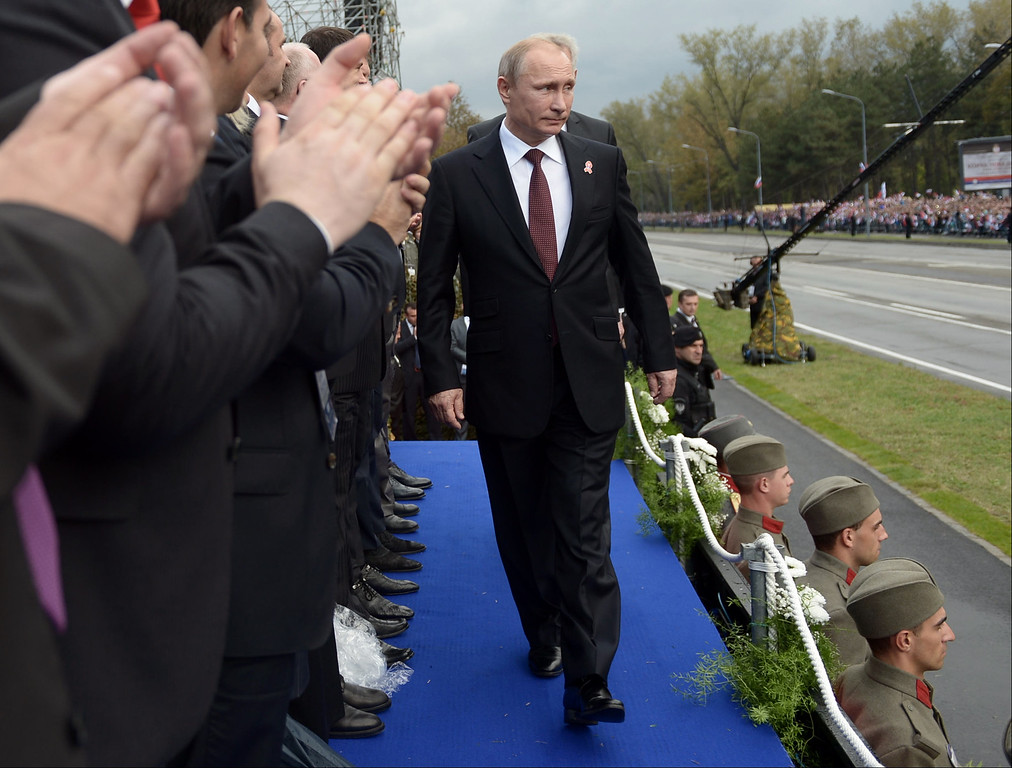 ". Russian President Vladimir Putin arrives to attend a military parade in Belgrade, Serbia, Thursday, Oct. 16, 2014. Greeted by enthusiastic chants of ""Putin! Putin!,\"" Russian President Vladimir Putin attended a military parade Thursday in Slavic ally Serbia, where he held talks on economic issues, including on the South Stream gas pipeline opposed by the European Union. (AP Photo/Vasily Maximov, Pool)"