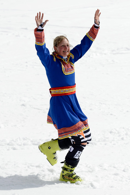 . Tanja Poutiainen of Finland cheers in a traditional costume after the women\'s giant slalom race at the alpine skiing World Cup finals in Lenzerheide, Switzerland, Sunday, March 16, 2014. Poutiainen finishes her career. (AP Photo/Keystone, Jean-Christophe Bott)