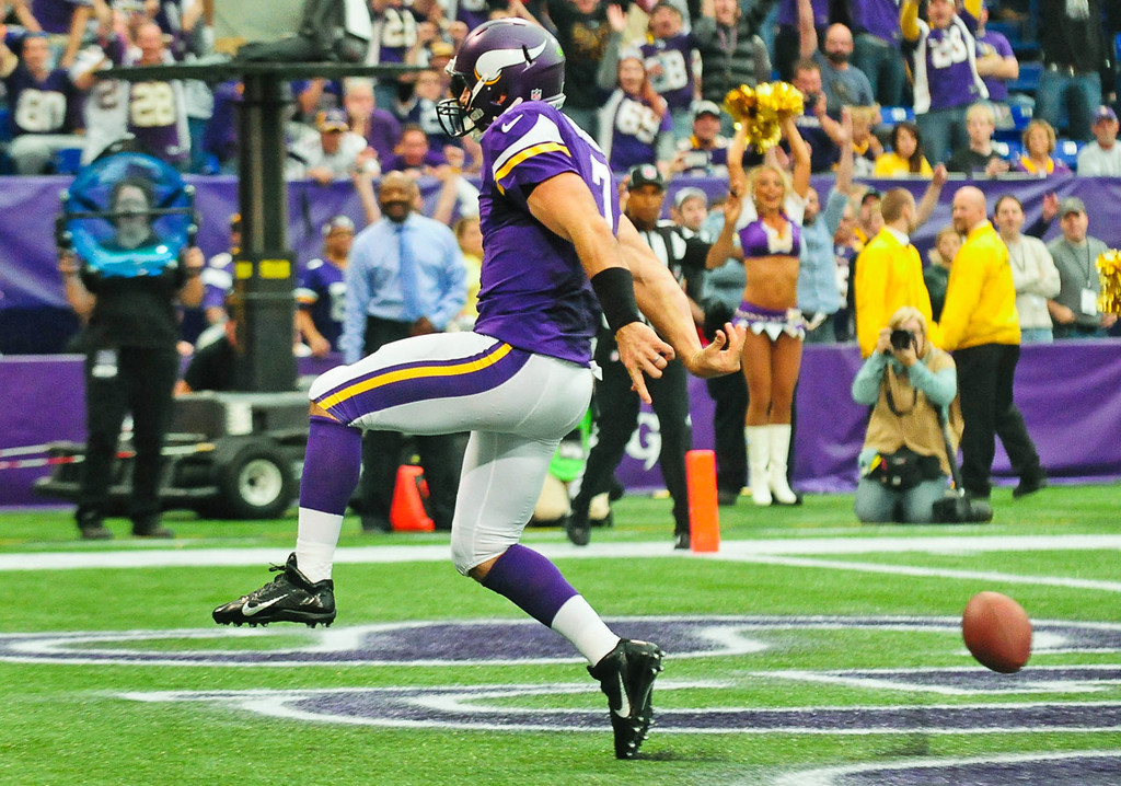 . Vikings quarterback Christian Ponder celebrates after scoring a touchdown on a 6-yard keeper in the second quarter against the Browns.  (Pioneer Press: Ben Garvin)