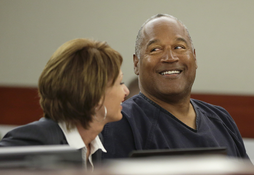 . O.J. Simpson (R) talks with his attorney, Patricia Palm during his evidentiary hearing in Clark County District Court May 13, 2013 in Las Vegas, Nevada. Simpson, who is currently serving a nine to 33-year sentence in state prison as a result of his October 2008 conviction for armed robbery and kidnapping charges, is using a writ of habeas corpus, to seek a new trial, claiming he had such bad representation that his conviction should be reversed.  (Photo by Julie Jacobson - Pool/Getty Images)