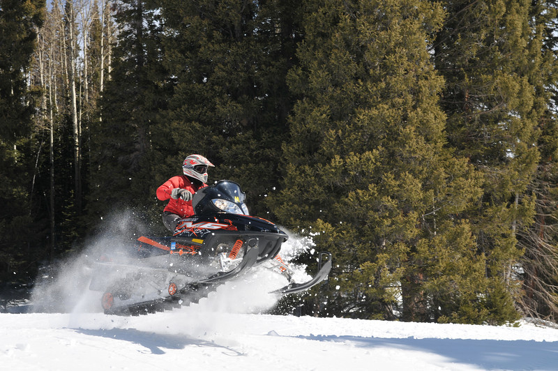 Wheeee! I like catching air on a snowmobile :)