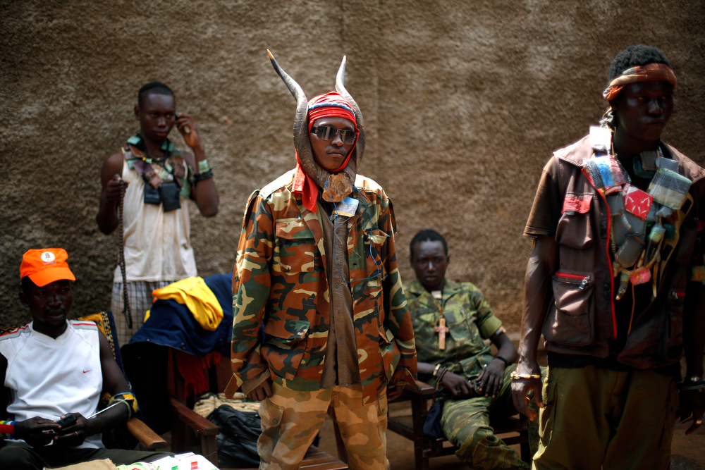 . Anti-Balaka Christian militiamen stand in the Combatant district of Bangui, Central African Republic, Tuesday Feb. 4, 2014. Fighting between Muslim Seleka militias and Christian anti-Balaka factions continues as French and African Union forces struggle to contain the bloodshed. (AP Photo/Jerome Delay)