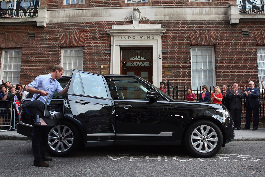 . Prince William, Duke of Cambridge leaves the Lindo Wing of St Mary\'s Hospital with his newborn son on July 23, 2013 in London, England.  The Duchess of Cambridge yesterday gave birth to a boy at 16.24 BST and weighing 8lb 6oz, with Prince William at her side. The baby, as yet unnamed, is third in line to the throne and becomes the Prince of Cambridge.  (Photo by Oli Scarff/Getty Images)