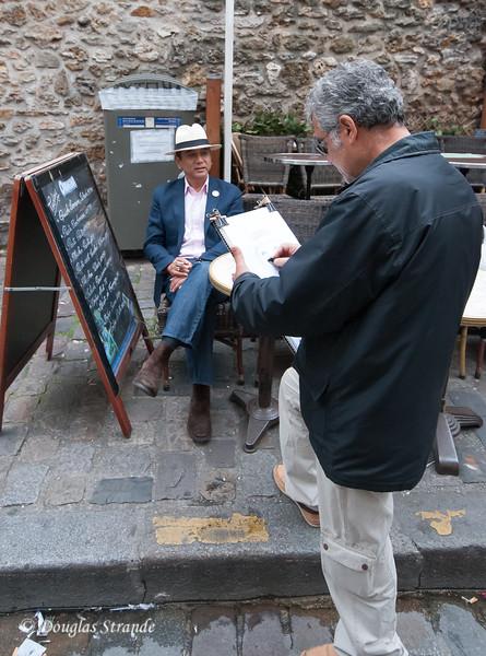 A street artist drawing a portrait