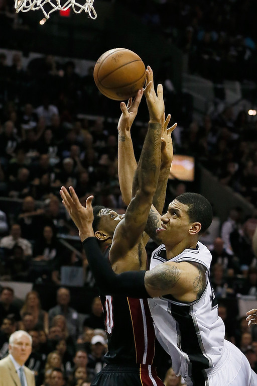 . Danny Green #4 of the San Antonio Spurs goes up for a shot against Udonis Haslem #40 of the Miami Heat in the second quarter during Game Five of the 2013 NBA Finals at the AT&T Center on June 16, 2013 in San Antonio, Texas. (Photo by Kevin C. Cox/Getty Images)