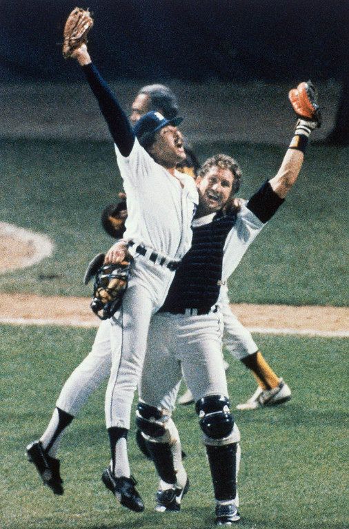 . Pitcher Willie Hernandez and, left, and catcher Lance Parrish hug after their Detroit Tigers beat San Diego to win the World Series, Sunday, Oct. 15, 1984, Detroit, Mich. (AP Photo/Ron Heflin)