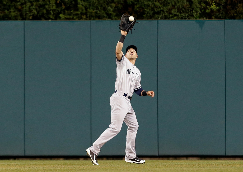 . New York Yankees center fielder Jacoby Ellsbury catches a Detroit Tigers left fielder Rajai Davis fly ball in the fourth inning of a baseball game in Detroit Tuesday, Aug. 26, 2014. (AP Photo/Paul Sancya)