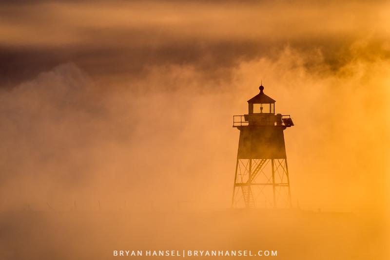 Lighthouse and Sea Smoke