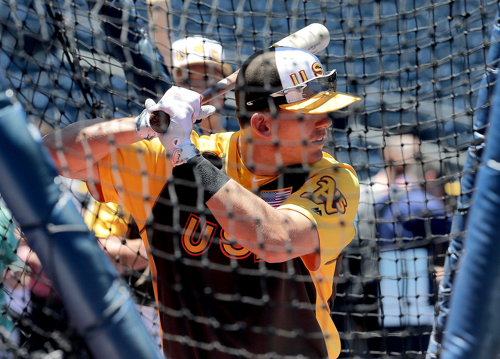 . U.S. Team\'s Ryon Healy, of the Oakland Athletics, hits prior to the All-Star Futures baseball game against the World team, Sunday, July 10, 2016, in San Diego. (AP Photo/Matt York)