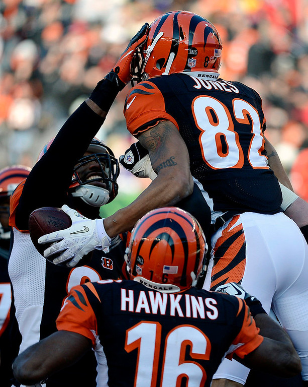 . Cincinnati Bengals wide receiver Marvin Jones (82) celebrates after scoring on an 11-yard pass reception in the first half of an NFL football game against the Baltimore Ravens, Sunday, Dec. 30, 2012, in Cincinnati. (AP Photo/Michael Keating)