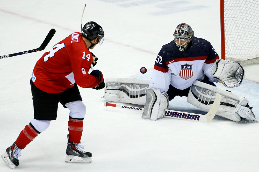 . USA goaltender Jonathan Quick blocks Canada forward Chris Kunitz\'s shot on the goal during the third period of a men\'s semifinal ice hockey game at the 2014 Winter Olympics, Friday, Feb. 21, 2014, in Sochi, Russia. (AP Photo/Matt Slocum)