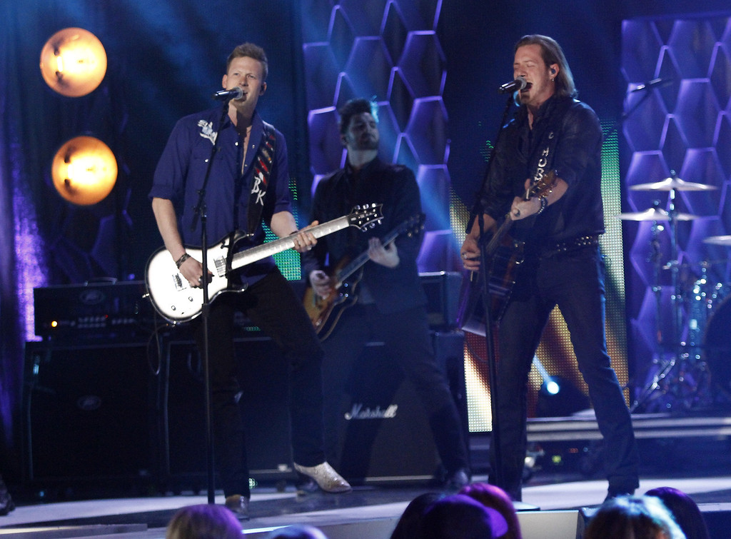 ". Brian Kelley, left, and Tyler Hubbard of Florida Georgia Line perform at CMT ""Artists of the Year\"" show held at the Music City Center on Tuesday, Dec. 3, 2013, in Nashville, Tenn. (Photo by Wade Payne/Invision/AP)"