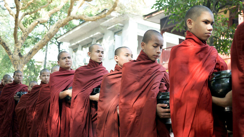 Monks patiently wait for lunch at Maha Gandayon Monastery