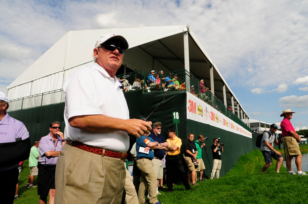 . Hollis Cavner, Executive Tournament Director, watches play just off the 18th green on the final day of the 3M Championship. (Pioneer Press: Scott Takushi)