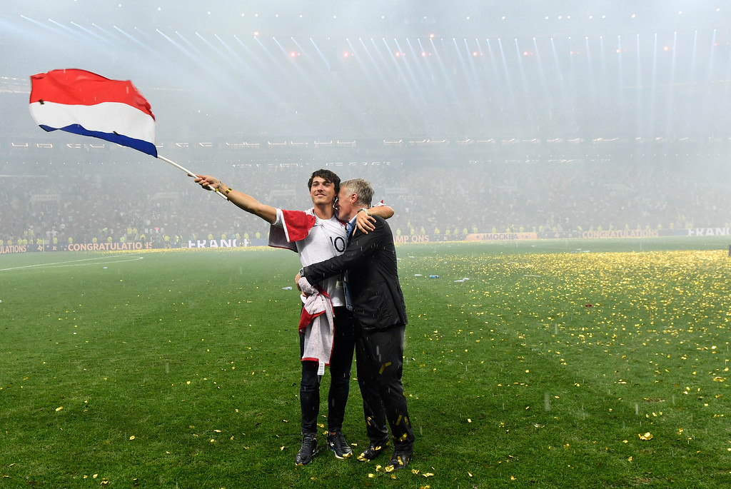 . France head coach Didier Deschamps, right, celebrate with his son Dylan after France won 4-2 during the final match between France and Croatia at the 2018 soccer World Cup in the Luzhniki Stadium in Moscow, Russia, Sunday, July 15, 2018. (AP Photo/Martin Meissner)