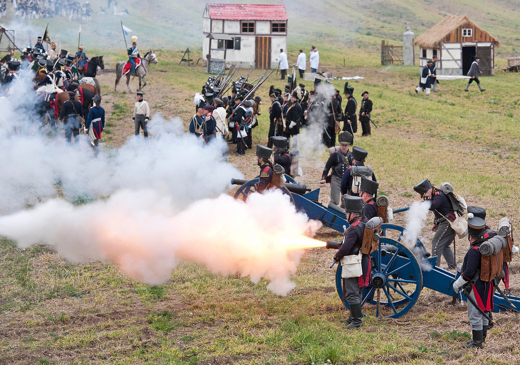 . Troops are shooting with cannons during the reconstruction of the Battle of the Nations at the 200th anniversary near Leipzig, central Germany, Sunday, Oct. 20, 2013. Some 6,000 members of military-historic associations from 24 countries took part in this performance.  (AP Photo/Jens Meyer)