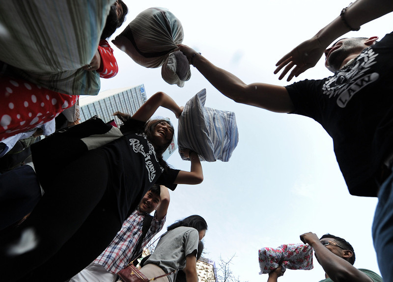 . People hit each other with pillows during the fourth international pillow fight day in Hong Kong on April 5, 2014. Some two hundred people formed a sea of pillows and loose feathers as they went at each other while wearing a colourful assortment of pajamas. (DALE de la REY/AFP/Getty Images)