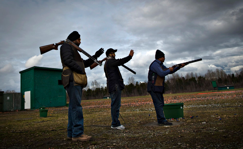 Description of . Shooters check the angle while waiting for their turn during skeet shooting at the Vancouver Gun Club in Richmond, British Columbia February 17, 2013. Formed in 1924, the Vancouver Gun Club, which is a shotgun-only club, has a regular membership of about 400 and sells an estimated 1100 day passes each year. Canada has very strict laws controlling the use of handguns and violent crime is relatively rare. Picture taken February 17, 2013.  REUTERS/Andy Clark