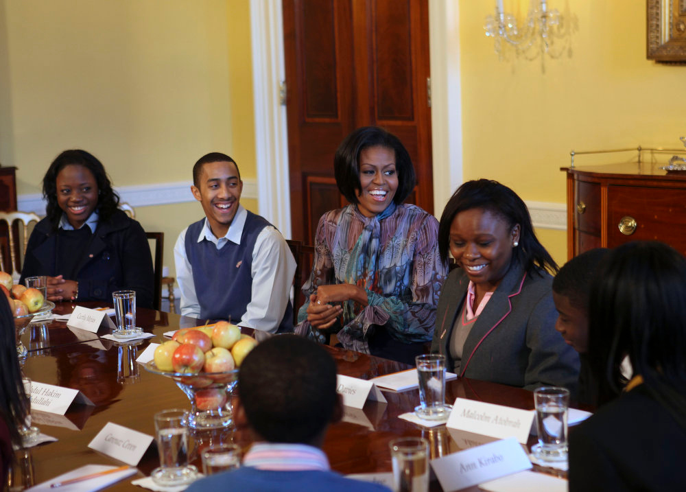 Description of . First lady Michelle Obama meets with students from schools across the London borough of Islington, at the White House in Washington, Thursday, Feb. 18, 2010, who were rewarded with a trip to the United States sponsored by the U.S. Embassy in London for winning an Islington Black History Month essay competition. (AP Photo/Gerald Herbert)