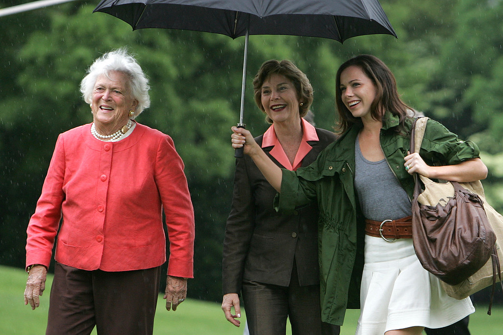 . First Lady Laura Bush, center, with her mother-in-law Barbara Bush, left, and daughter, Barbara, arrive on the South Lawn of White House in Washington, Sunday, May 11, 2008. (AP Photo/Lawrence Jackson)