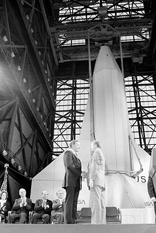 . President Jimmy Carter, right, congratulates former astronaut and first man on the moon Neil Armstrong after presenting him a medal at the VAB on Cape Canaveral on Oct. 1, 1978. Other spacemen also cited included, from left John Glenn, Charles Conrad Jr. and Frank Borman. Also receiving awards were Mrs. Betty Grisson and Alan Shepard. (AP Photo/Jeff Taylor)