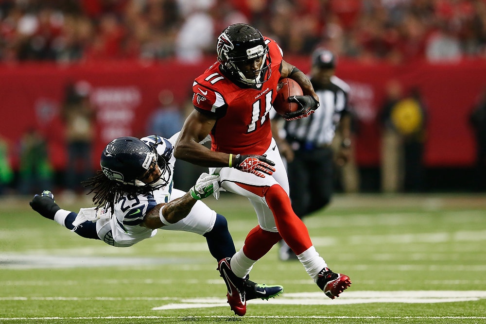 . Julio Jones #11 of the Atlanta Falcons tries to avoid the tackle of  Earl Thomas #29 of the Seattle Seahawks during the NFC Divisional Playoff Game at Georgia Dome on January 13, 2013 in Atlanta, Georgia.  (Photo by Kevin C. Cox/Getty Images)
