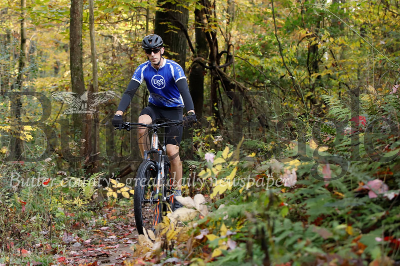 Jeff Platt of Butler cruises through fall foliage on the trails at Alemeda Park Tuesday. Seb Foltz/Butler Eagle