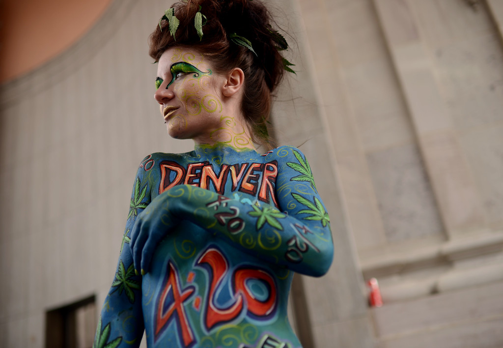 . DENVER, CO. - APRIL 20 : Triana Rice is body painted by artist Sophia Rose for the celebration of 4/20 at Civic Center Park in Denver. A crowd of marijuana smokers gathered at the park to mark the counterculture holiday known as 4/20 on the first celebration since Colorado and Washington made pot legal for recreation use. (Photo By Hyoung Chang/The Denver Post)